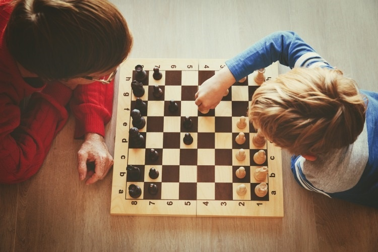 father-and-son-play-chess-picture-id854379264