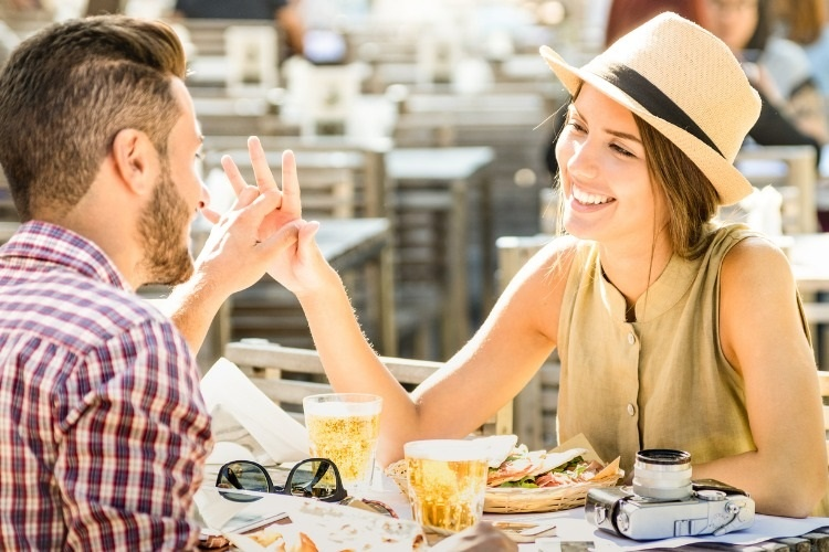 couple-in-love-having-fun-at-beer-bar-on-travel-excursion-young-happy-picture-id667577424