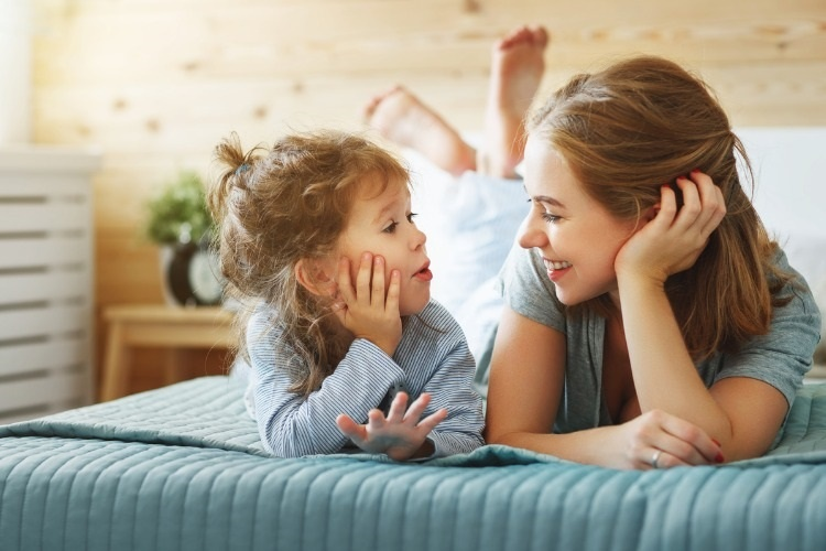 happy-family-mother-and-child-daughter-laughing-in-bed-picture-id906390414