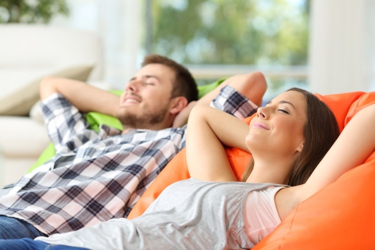 couple-or-roommates-relaxing-at-home-picture-id638657234_01