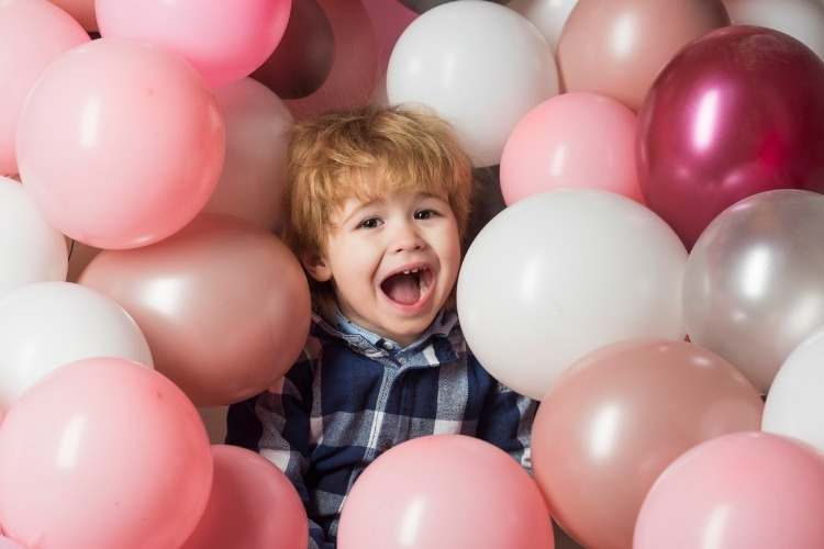 child-screams-in-balloons-cute-crying-at-party-beautiful-background-picture-id930295978