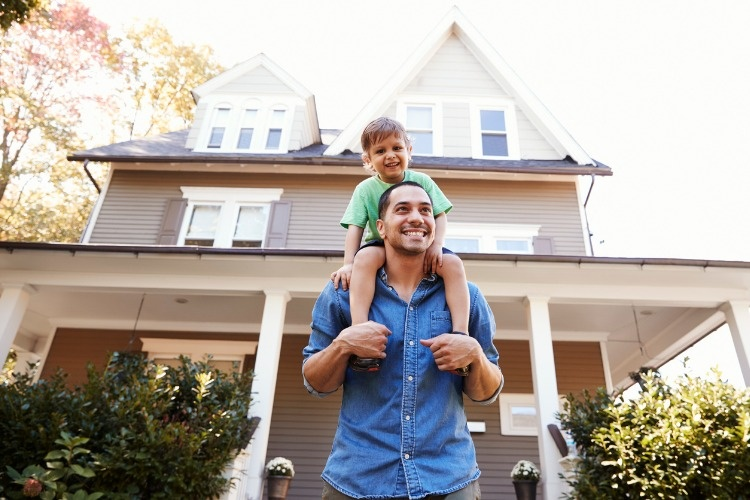 father-giving-son-ride-on-shoulders-outside-house-picture-id905899106