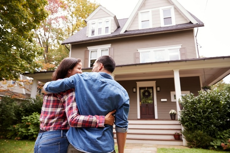 rear-view-of-loving-couple-walking-towards-house-picture-id905902112
