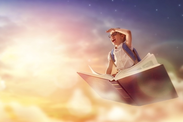 child-flying-on-the-book-picture-id830255472_01