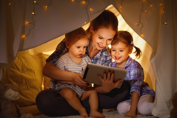 happy-family-mother-and-children-playing-in-tablet-pc-picture-id664423956