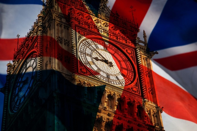 union-jack-flag-and-iconic-big-ben-at-the-palace-of-westminster-the-picture-id672219580