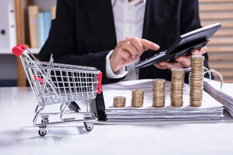 stack-of-increasing-coins-and-shopping-cart-picture-id917895472_01