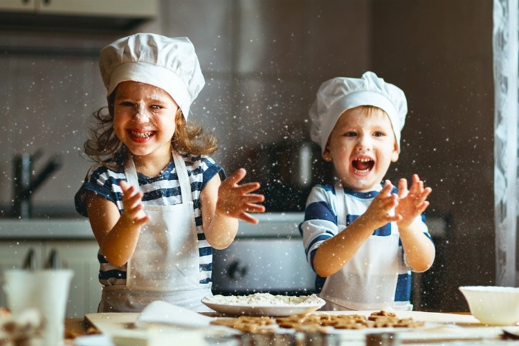 happy-family-funny-kids-bake-cookies-in-kitchen-picture-id664420980