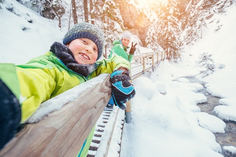 boy-take-a-selfie-picture-with-his-father-in-snow-mountain-canyon-picture-id864753036
