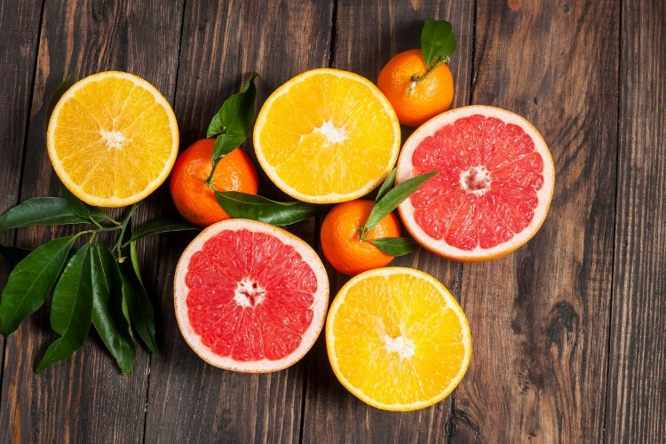 citrus-fruits-over-wooden-table-background-picture-id502964550_01