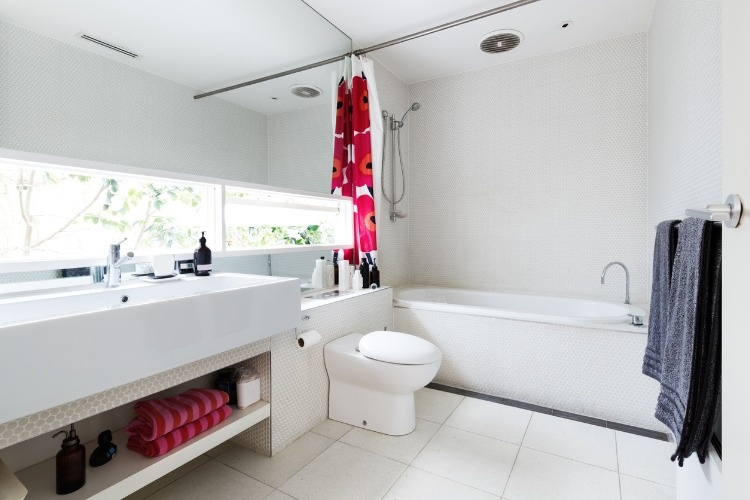 modern-renovated-white-mosaic-tiled-family-bathroom-with-red-and-pink-picture-id876417356
