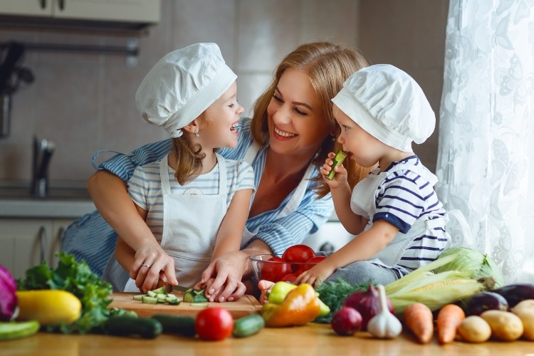 healthy-eating-happy-family-mother-and-children-prepares-vegetable-picture-id845508958