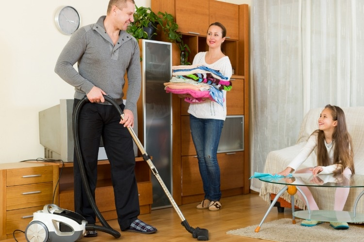 mother-father-and-girl-doing-general-cleaning-picture-id503612410