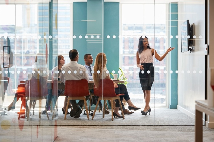 female-boss-shows-presentation-on-screen-at-business-meeting-picture-id869282952_03