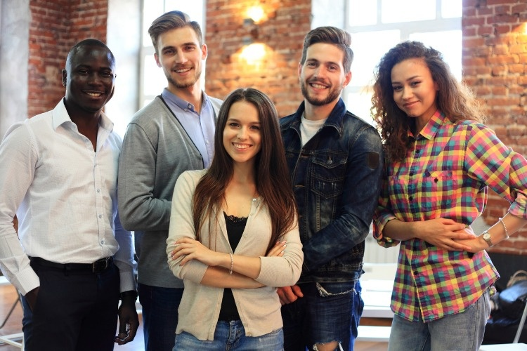 portrait-of-creative-business-team-standing-together-and-laughing-picture-id829936458_01