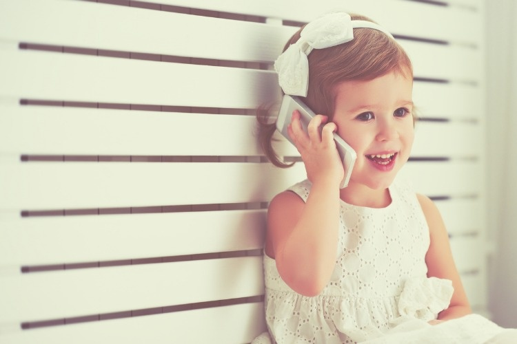 child-little-girl-with-telephone-smartphone-picture-id507458424