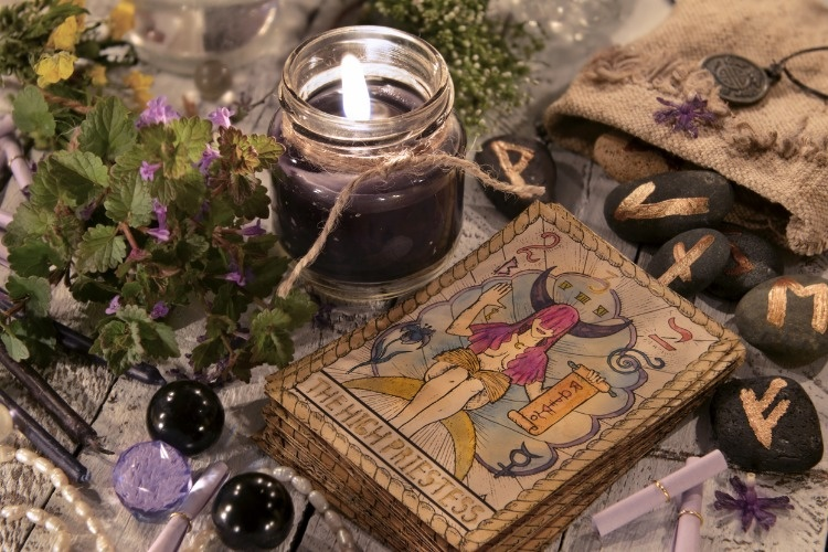black-candle-with-the-tarot-cards-and-runes-picture-id802164226