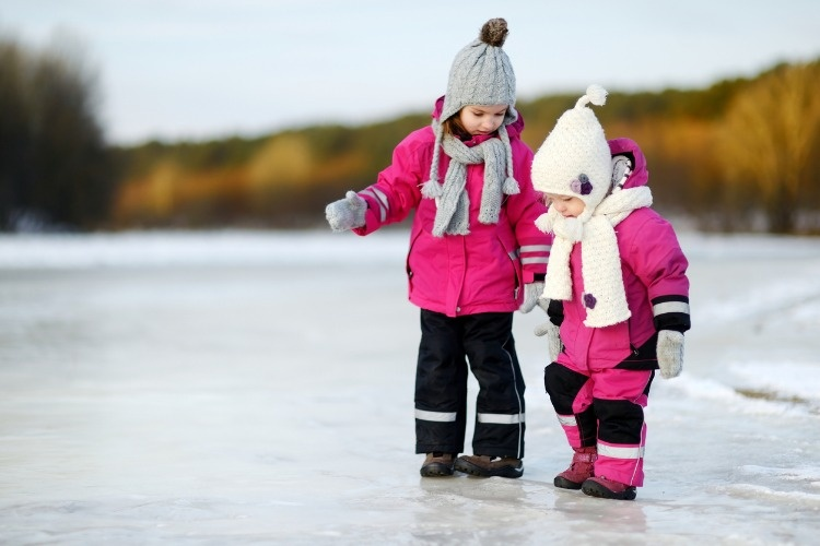 two-little-sisters-having-fun-on-snowy-winter-day-picture-id881260702