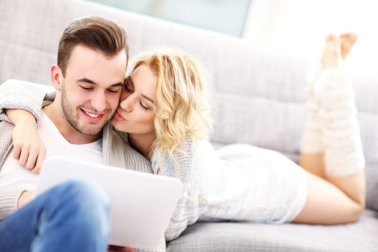 romantic-couple-with-laptop-in-living-room-picture-id508939468