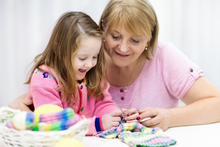 mother-and-child-knitting-knit-wear-crafts-with-kids-picture-id865410578