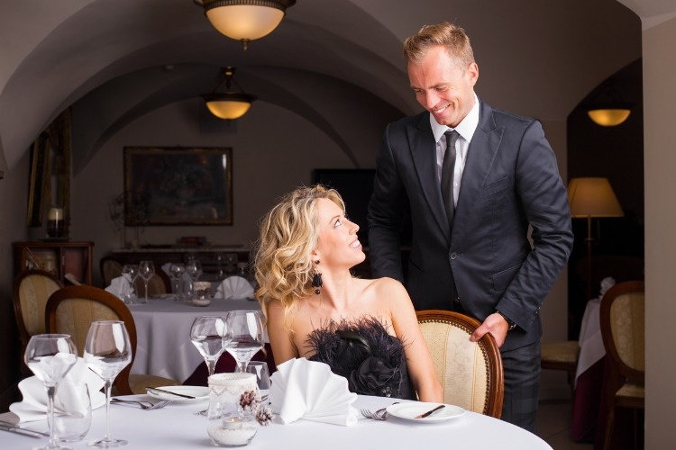man-being-a-gentleman-and-helping-woman-with-her-chair-picture-id501569926_01