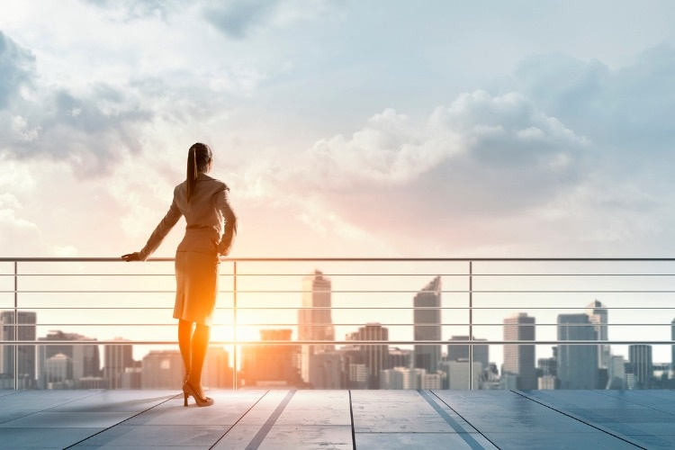 businesswoman-on-building-roof-mixed-media-picture-id630958686_02