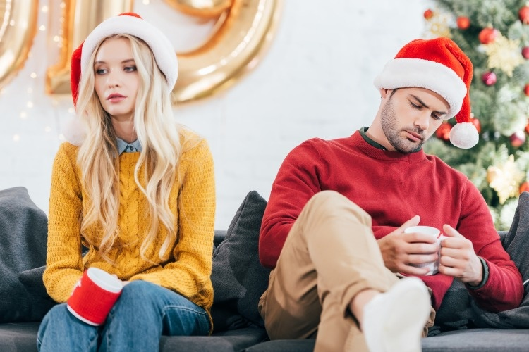 upset-couple-in-bad-mood-holding-cups-of-coffee-and-sitting-at-home-picture-id1044645926