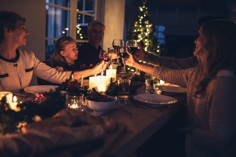 happy-extended-family-having-christmas-dinner-at-home-picture-id856020830