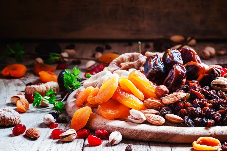 dried-apricots-dates-raisins-and-various-nuts-picture-id530508382