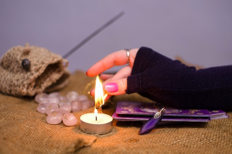 lights-a-candle-for-divination-picture-id468576080