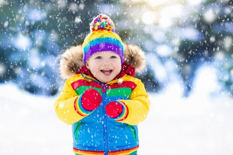 child-playing-with-snow-in-winter-kids-outdoors-picture-id867926106