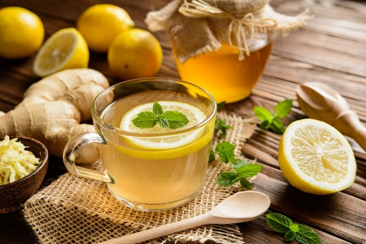 ginger-root-tea-with-lemon-honey-and-mint-picture-id590242446