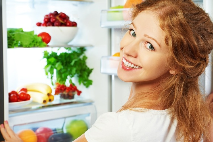 happy-woman-and-open-refrigerator-with-fruits-vegetables-and-he-picture-id481070252_01