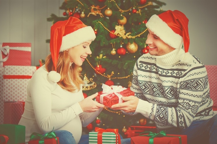happy-family-couple-with-a-gift-on-christmas-at-home-picture-id495612172