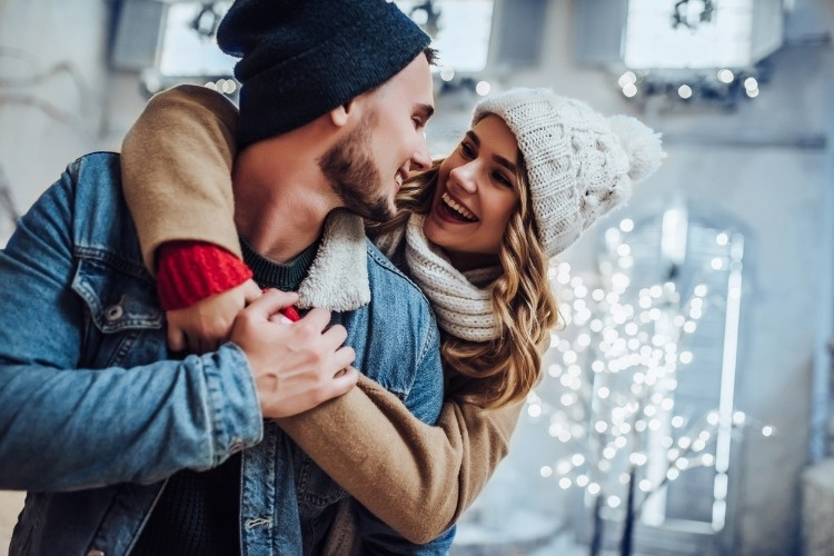 young-romantic-couple-is-having-fun-outdoors-in-winter-picture-id876957568