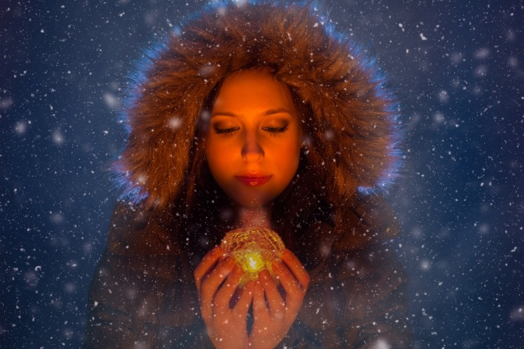 young-woman-with-magic-light-in-hands-at-night-during-a-snowstorm-picture-id950649852_03