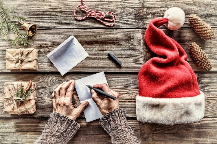 conception-christmas-making-christmas-gifts-a-man-writes-a-letter-picture-id884893990