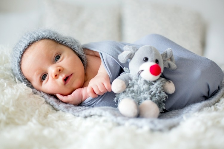 little-newborn-baby-boy-looking-curiously-at-camera-picture-id858115532
