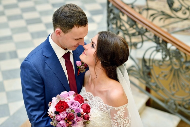 wedding-couple-indoors-is-hugging-each-other-picture-id614720628