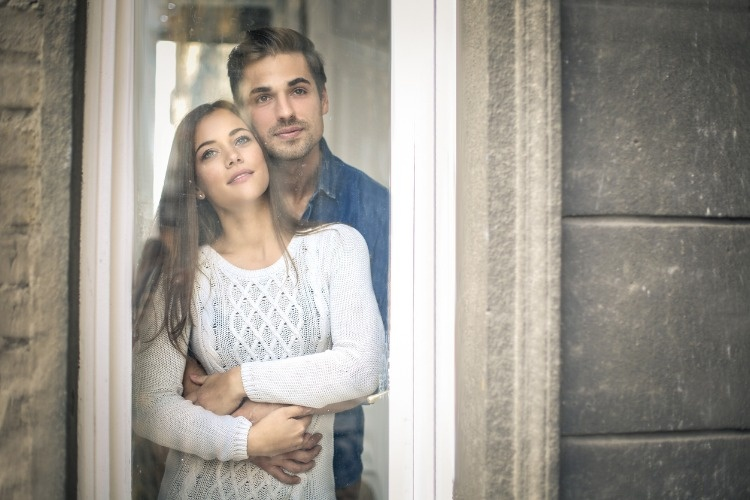 romantic-couple-looking-out-of-the-window-picture-id859817524