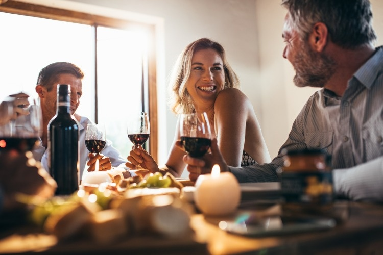 friends-having-great-time-at-dinner-party-picture-id952334480