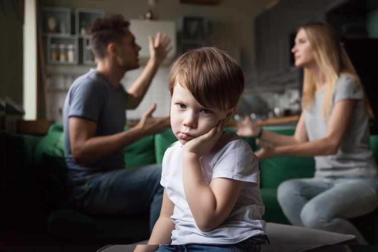 sad-kid-son-feeling-bored-and-tired-of-parents-fighting-picture-id1028900484