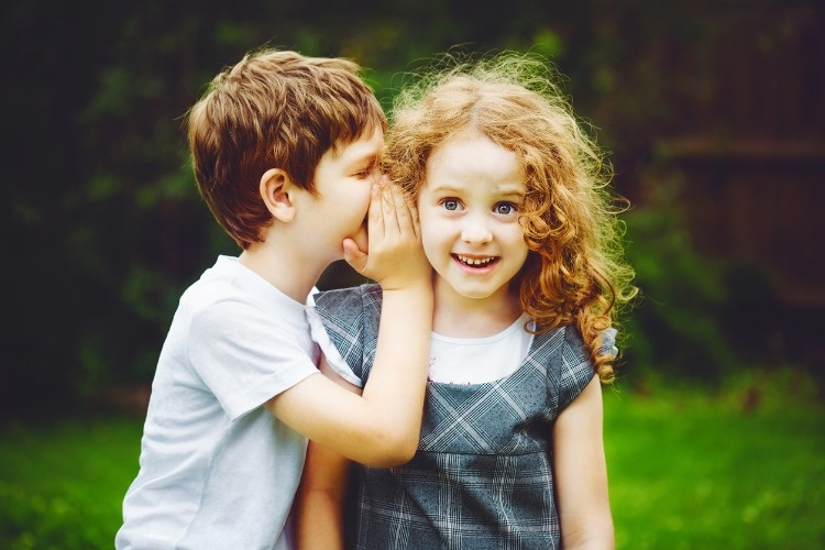 little-boy-and-girl-whispers-picture-id505172994