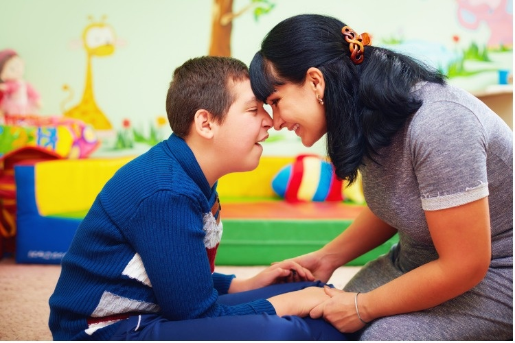soulful-moment-portrait-of-mother-and-her-beloved-son-with-disability-picture-id858352516_01