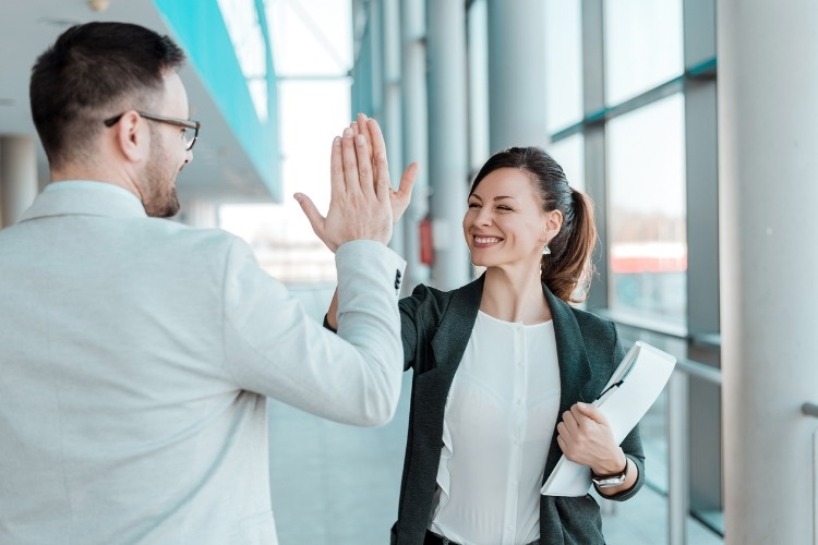 two-excited-business-colleagues-team-give-high-five-picture-id903770892