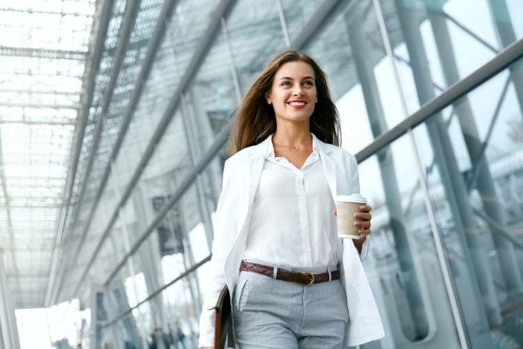 beautiful-woman-going-to-work-with-coffee-picture-id970923568_01