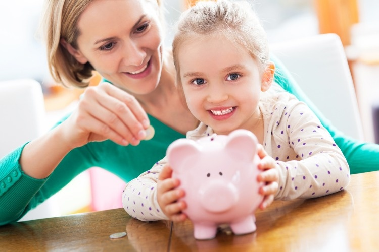 mother-and-daughter-playing-with-piggy-bank-picture-id156796282